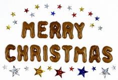 Beschriftung der frohen Weihnachten mit Sternen Stockfotografie