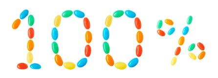 Beschriftung 100% gemacht von den mehrfarbigen Süßigkeiten lokalisiert auf Weiß Stockfotos