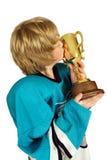 Bese la taza Imagen de archivo libre de regalías