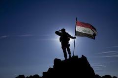 Besegrare med en flagga Arkivfoton
