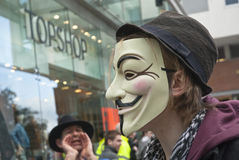 Besetzen Sie den Exeter-Aktivisten, der eine Kerl Fawkes Schablone trägt Stockfotografie