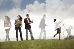 Besetzte Geschäftsleute in Bewegung Lizenzfreies Stockfoto