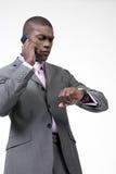 Besetzter Geschäftsmann am Telefon Stockbild