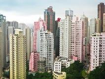 Skycrapers rosa färg och vit i Hong Kong Fotografering för Bildbyråer