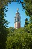 Bell står hög med ängel i Udine Arkivfoto