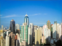 Skycrapers i Hong Kong med sun 2 Royaltyfri Foto