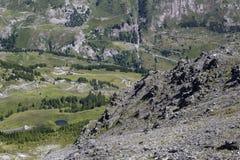 Beskåda ner från Muret till några bergbyar Royaltyfri Foto