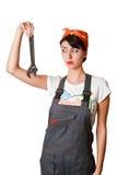 Besluiteloos meisje met moersleutel Stock Fotografie