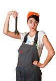 Besluiteloos meisje met moersleutel Stock Foto's