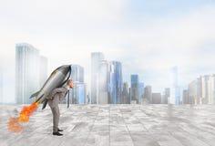 Beslutsamhet- och maktaffärsman som rymmer en raket Arkivbild