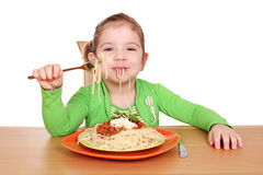 Besmear little girl eating spaghetti Stock Images