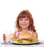 Besmear little girl with sandwich Stock Photography