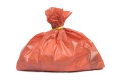 Besmettelijk afval in rode zak stock fotografie