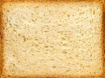 Besnoeiing van een wheaten lang brood. Royalty-vrije Stock Foto