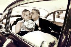 Beso en el asiento trasero Imagenes de archivo