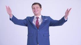 Beso que sopla del hombre de negocios hermoso joven feliz almacen de metraje de vídeo