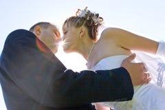 Beso a través del sol Fotos de archivo