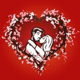 Besos lindos de los pares en un corazón del flor Foto de archivo