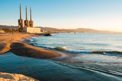 Besos river estuary landscape of badalona with. Besos estuary landscape of with `tres xemeneies` from in the early morning at sunrise from barcelona side royalty free stock photos