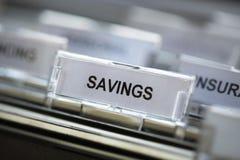 Besparingar som heading i dokumentskåp Arkivbild