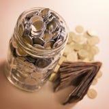 Besparingen in glaskruik Stock Afbeelding