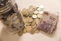 Besparingen Mexicaanse munt Stock Afbeeldingen