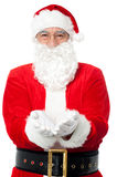 Bespectacled Father Santa posing with open palms Stock Photo