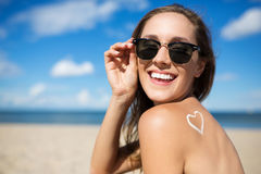 Bespectacled woman with heart sign on back laughing. Portrait of bespectacled woman with heart sign on back laughing Stock Photo