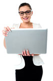 Bespectacled woman holding a laptop Stock Photos