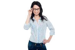 Bespectacled young woman in trendy wear Royalty Free Stock Photos