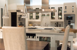 Bespoke Kitchen. Luxury and Contemporary Stylish Bespoke Kitchen Dinner with Modern Appliances and Furniture Royalty Free Stock Photo