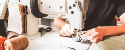 Bespoke service seamstress threading needle. Bespoke service. Cropped shot of seamstress sewing clothes and threading needle royalty free stock images
