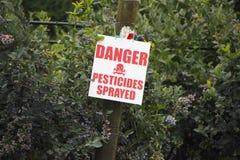 Besprutat tecken för fara bekämpningsmedel Arkivbilder