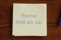 Besser spät als nie.Better late than never in German Royalty Free Stock Photography