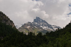 The Besso peak. Besso (3667 m) is a mountain in the Pennine Alps in the Swiss canton of Valais Stock Image