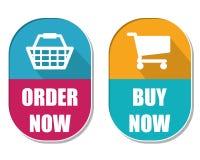 Beställa nu och köp nu med shoppingkorgen och cart tecken, två e Arkivbilder