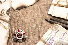 Beställning av det patriotiska kriget, de gamla bokstäverna och fotona Arkivfoto