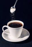 Bestänkande av socker Arkivbilder