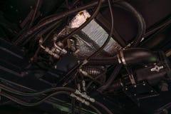 Beståndsdel av motorsystemet av den ny modern jordbruks- traktoren eller sammanslutning eller skördearbetare royaltyfria foton