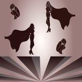 Beståndsdelar för huka sig ned kvinna- och superheroines skugga Fotografering för Bildbyråer