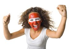 We are the best!. Young screaming Austrian sport's fan with painted flag on face and with clenched fist. Front view. Looking at camera, white background Royalty Free Stock Photo
