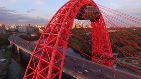 Red Zhivopisny Bridge in Moscow city, Unique quadcopter views. Eric sunset, Road Traffic. From above. Best aerial view Moscow city Unique quadcopter views. Eric stock footage