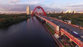 Red Zhivopisny Bridge in Moscow city, Unique quadcopter views. Eric sunset, Road Traffic. Approach. Best aerial view Red Zhivopisny Bridge Moscow Unique stock video