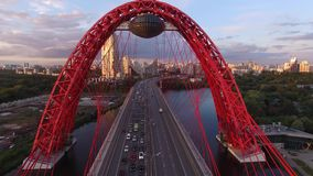 Red Zhivopisny Bridge in Moscow city, Unique quadcopter views. Eric sunset, Road Traffic. Flight inside. Best aerial view Red Zhivopisny Bridge Moscow Unique stock footage