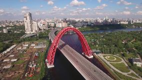 Best aerial view ad Red Zhivopisny Bridge in Moscow city, Unique quadcopter views. Sunny day, Road Traffic. From above. Best aerial view Unique quadcopter views stock footage