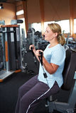 Best Ager doing workout in gym Stock Image
