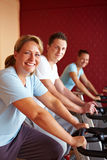 Best Ager on spinning bicycles Stock Photos