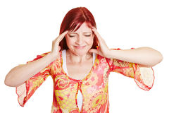 Best ager woman with headaches Royalty Free Stock Image