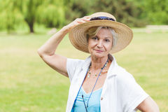 Best ager women outoors with hat stock photos