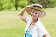 Best ager women outoors with hat Royalty Free Stock Photos